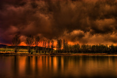 Storm Clouds at Sunset (Thad Roan - Bridgepix) Tags: trees light sunset orange sunlight foothills lake storm mountains reflection green water grass silhouette clouds colorado denver explore chatfield hdr littleton photomatix 200805