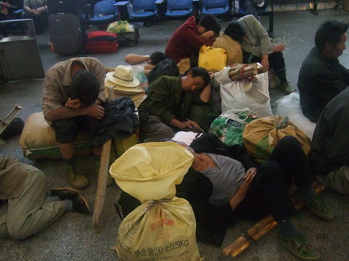 Sleeping migrant workers by Kongharald.