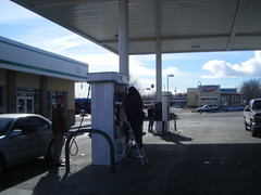 pumping gas (bradleygee) Tags: people cars three colorado union gas gasstation pump co worker ladder lakewood wahoos fishtacos