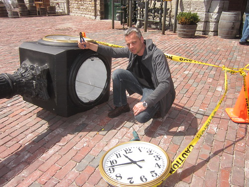 the electricien looks at the custom clock in the distillery district