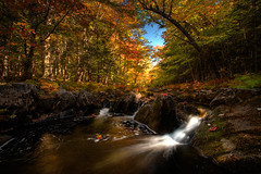 Autumn (iJohn) Tags: blue autumn red orange tree green fall yellow forest river waterfall moss stream novascotia falls brook naturesfinest 25faves