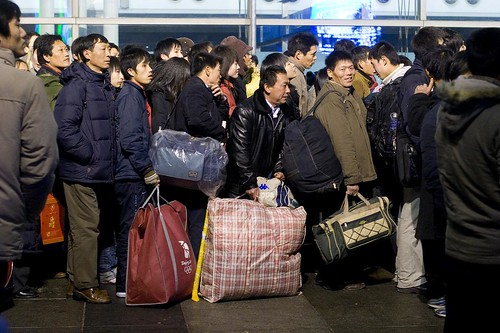 Millions of Chinas migrant workers wait in line to board trains to get home in time for Chinese New Year.