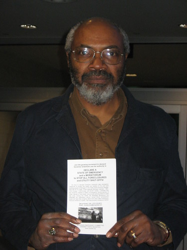 "Abayomi Azikiwe, Pan-African News Wire editor, holds the infamous MECAWI leaflets that required a federal court order to distribute at a ""avoid foreclosure"" fair in downtown Detroit. (Photo: Cheryl LaBash). by Pan-African News Wire File Photos"