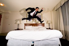 hotel room jump while wearing a suit (poopoorama) Tags: wedding selfportrait canada me vancouver hotel jump britishcolumbia sigma danny 1020mm sigma1020mm day286 365days plaza500 strobist