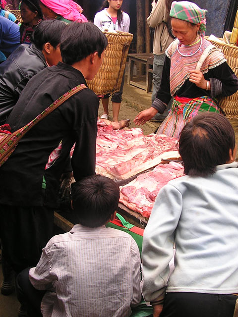 Shopping for pork at Bac Ha Market