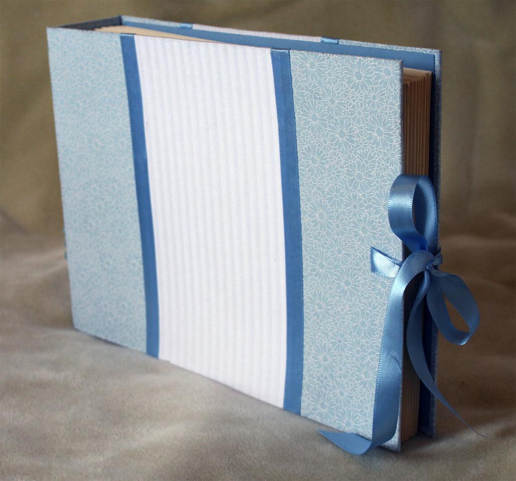 Livro/album azul e branco
