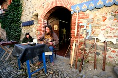 Medieval Artisan in action (Sergio Verna) (! .  Angela Lobefaro . !) Tags: trip travel vacation italy castle ruins italia quality elmo medieval piemonte axe schloss biella castello borgo medievale piedmont castillo artisan artigiano allrightsreserved helm burg medeival medioevo medioevale medioeval nyckelharpa candelo symphonia ghironda halberd poleaxe liuto ricetto ricettodicandelo angiereal pemonte visitpiedmont maxgreco angelalobefaro angelamlobefaro organistrum sergioverna liute mariagueretta massimilianogreco angelalobefaropiedmont angelalobefaro
