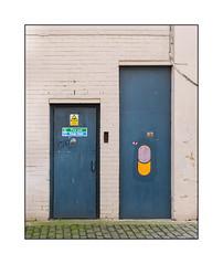 Street Art (Miles Khan), South London, England. (Joseph O'Malley64) Tags: mileskhan builtenvironment streetart urbanart graffiti art artist artistry artwork pasteup wheatpaste paper mixedmedia brickwork bricksmortar pointing paint painted doors woodendoors firedoors doorways entrances exits concrete cobbles cobblestones cobbledpathway lightningconductor copperearthingstrap signs signage cctv fireexit healthsafety southlondon london england uk britain british greatbritain
