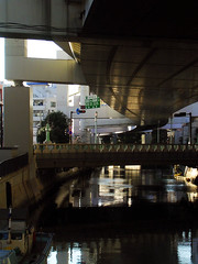 curve and reflection (Molly Des Jardin) Tags: bridge light white reflection home water yellow japan river concrete shadows curves gray shapes infrastructure yokohama expressway brilliance 2007 ishikawacho