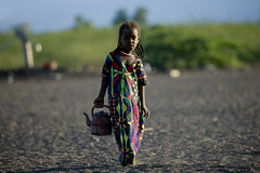 Girl bringing water from the well, Danakil, Ethiopia (Eric Lafforgue) Tags: poverty africa people horizontal photography day child african fulllength culture tribal females tradition ethiopia tribe ethnic oneperson tribo traditionalculture childlabor hornofafrica ethnology ethiopian afar eastafrica thiopien etiopia ethiopie traditionalclothing realpeople etiopa colorimage lookingatcamera 45years  traveldestination danakil etiopija pastoralist ethiopi mg1800  africanculture onegirlonly etiopien etipia  etiyopya    asaita  assayta