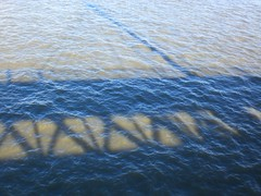 Hungerford Bridge shadowed on the river (Joanne Murphy) Tags: winter london thames hungerfordbridge waterloobridge mywalktowork