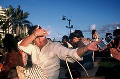 Cell Phone Hand-off (Michael Ronquillo) Tags: hawaii still waikiki oahu cellphone tourists slidefilm honolulu nocrop july2002 handoff veselysmom bymichaelronquillo michaelronquillophotography
