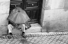 lonely man (GArrAGhER) Tags: madrid street people españa umbrella calle spain solitude gente doorway lonely portal soledad paraguas solitario principepio