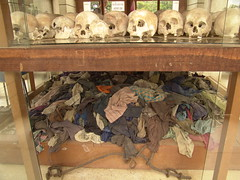 Skulls have clothes (Saint Robert's Journey) Tags: old travel family girls boy people men history robert archaeology boys girl saint naked nude dead skulls death skull scary ancient women cambodia kill die time reaper families photojournalism tourist graves historic forgotten torture end bones murder historical killed bone mean monsters afraid pointless past archaeological genocide global died archeological cruelty cruel photography saint mass fields touristism killing graves grim reaper robert