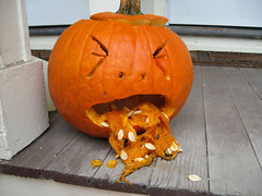 halloween aftermath (carrie227) Tags: orange fall halloween pumpkin candy jackolantern pumpkins barf bleh puke vomit neighborsporch