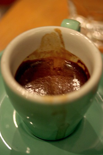 Inside his espresso cup...