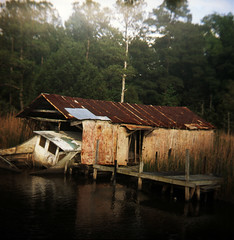 (beebo wallace) Tags: abandoned 120 film water creek mediumformat boat fuji coastal nautical spartusfullvue fujichromeprovia400f alligatorcreek stonewallnc