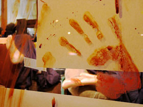 Bloody handprint on Mintage's display window