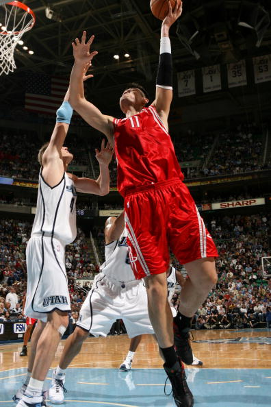Yao Ming shoots over Utah's Andrei Kirilenko in a game where Yao struggled offensively with 11 points on 5-of-14 shooting, but he had a great defensive game to help get payback against Utah in a 106-95 win.