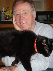 charles with 1 of 9 cats