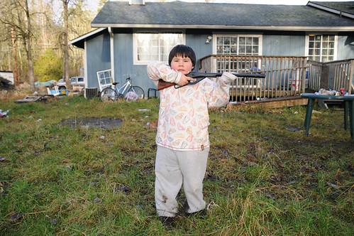 holding bb gun_2539 web_ christmas present xmas