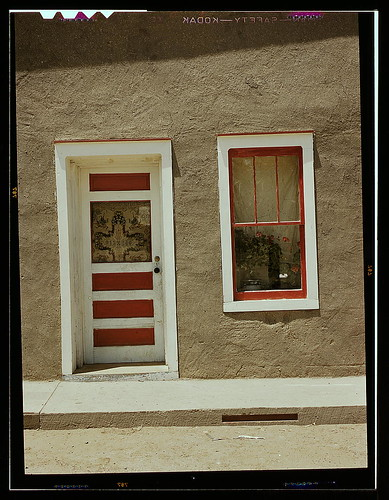 Door and window in a Spanish-American home, Costilla, New Mexico (LOC) by The Library of Congress.