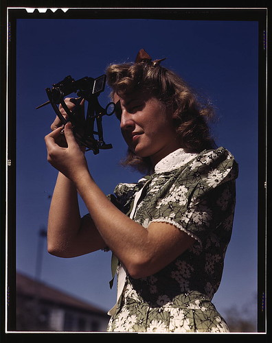 Learning how to determine latitude by using a sextant is Senta Osoling, student at Polytechnic High School, Los Angeles, Calif. Navigation classes are part of the schools program for training its students for specific contributions to the war effort (LOC)