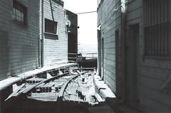 and the rest was history (lizlouie) Tags: sanfrancisco blackandwhite bw abandoned film pier kodak neglected tracks 55mm embarcadero minoltasrt rokkor