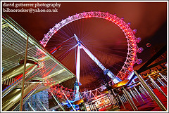 London Eye (david gutierrez [ www.davidgutierrez.co.uk ]) Tags: city longexposure red england urban building london eye colors architecture night buildings dark spectacular observation geotagged photography lights arquitectura cityscape riverside dusk sony centre perspective cities cityscapes londoneye milleniumwheel center front tourist structure architectural southbank explore citylights page architektur ferriswheel nights metropolis alpha topf100 frontpage riverthames thamesriver dt westminsterbridge hungerfordbridge nightfall cityoflondon municipality edifice jubileegardens cites  f4556  100faves 1118mm sonyalpha londonred sonyalpha350 alpha350 cantileveredobservationwheel mylondoneye sonyalphadt1118mmf4556 sony350dslra350