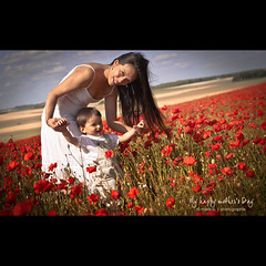 My happy Mother's Day :) (marie b&b | photographie) Tags: red portrait selfportrait france flower colour love parenthood nature field countryside child framed country mother 100v10f parent frame poppy poppies lovely mummy motherhood familyportrait campagne mothersday redflowers happyness cityart ftedesmres poppyfield redcolour poppiesfield oracope 10flickrawards flickraward5 flickrawardgallery