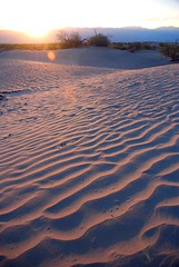 Sand waves (juliaclairejackson) Tags: california light sunset shadow usa sunlight holiday mountains hot reflection nature nationalpark sand solitude waves natural wind ripple dunes dry roadtrip panoramic heat deathvalley desolate barren arid tranquil sanddunes expanse isloated 120degrees didntcooldownatnight