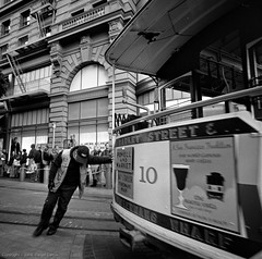 Weary weight (Focal Intent) Tags: sanfrancisco bw 120 6x6 film trix tourists scan hasselblad cablecar 500c diafine trolly operator powellstreet turnabout 320txp v700 txp320