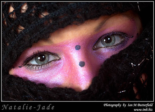 Pink make-up eyes wearing a scarf.