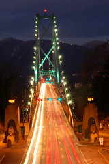 Lions Gate Bridge (Rob Bellinger) Tags: road bridge light red motion mountains green night vancouver whistler movement highway gate stream traffic lions rushhour roadway llightstream