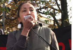 Norris speaking at a protest in October.