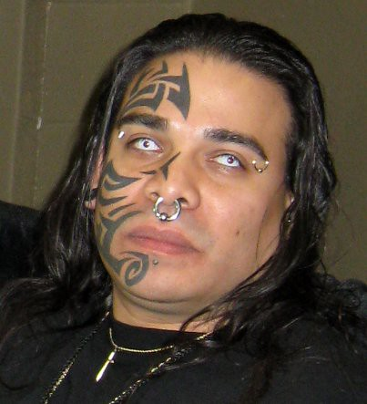 tattoos of faces gallery. the Neo-Nazi tattoos of a defendant in a murder trial where he faces the