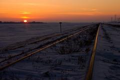 railset (Mr. Gee) Tags: winter sunset snow field rural train steel tracks rail manitoba prairie agriculture anawesomeshot flickrchallengewinner