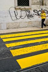 Street Fashion (halopes76) Tags: road woman color portugal yellow delete10 delete9 delete5 graffiti delete2 delete6 delete7 lisboa lisbon stripes delete8 delete3 delete delete4 save save2 save4 match crosswalk tramtrack 400d