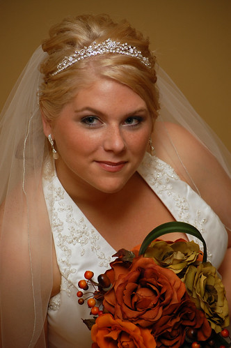 Wedding updos with tiara. Bridal hair with tiara and veil, bride in a tiara
