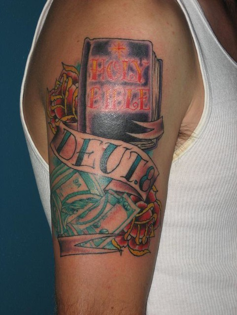 Bible Tattoo. Jimmy Kuder III tattoos at Nowhere Fast Tattoo