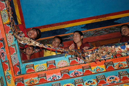 Tsok Chen adds decorations with his friends, Tharlam Monastery, Boudha, Kathmandu, Nepal by Wonderlane