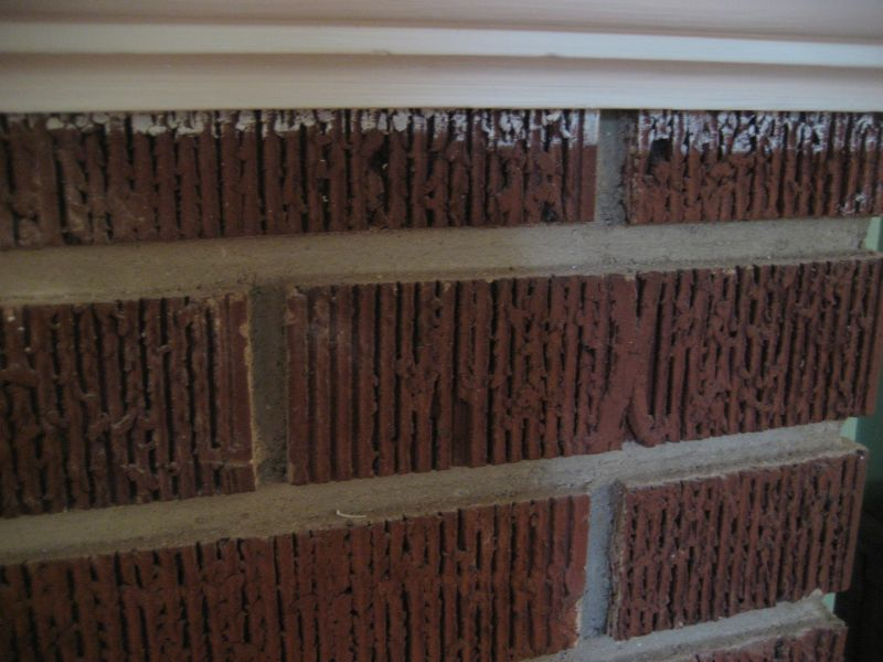Bad paint job on my fireplace by previous owners