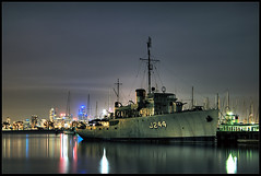 HMAS Castlemaine (Luke Tscharke) Tags: longexposure sky reflection water night canon geotagged eos lights bay pier ship australia melbourne victoria williamstown cbd hdr castlemaine rialto xsi hmas hobsons 2xp 450d canonefs1855mmf3556is digitalrebelxsi lushaki geo:lat=3786184 geo:lon=144904513 luketscharke