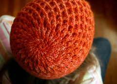 Spiraled (kathrynivy.com) Tags: orange holiday hat knitting knit merino grace yarn cables cap stocking 2008 koolhaas worsted 2007 interweaveknits cabled malabrigo interweave brooklyntweed glazedcarrot jaredflood