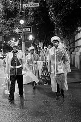 marchers, ready for rain (11644) (seanhoyer) Tags: sanfrancisco people bw streets 20d rain canon walking march banner chinesenewyear parade financialdistrict rainy marching oneway uniforms marchingband 2008 raincoats treasurehunt marchers jacksonstreet 35l cnyth yearoftherat ef35mmf14lusm canon35mmf14lusm 2008cnyth cnyth2008 verwimmin