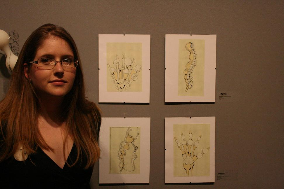 Elizabeth Hartman next to technical drawings