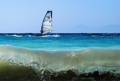 windsurfing (esther**) Tags: blue sea sky wave kisses explore greece rhodes themoulinrouge winsurfing interestingness12 interestingness15 loverhodes notasasillytourist