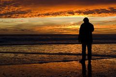 into the gold (cmedrang) Tags: sunset sea sky espaa man beach silhouette backlight clouds contraluz atardecer mar andaluca spain huelva playa cielo nubes silueta soe crisis hombre puntaumbra mywinners cmedrang