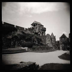 A Medieval House? (kycamlewis) Tags: bw france 120 6x6 holga perspective medieval walls sq fougeres ilforddeltapro400 skyuare