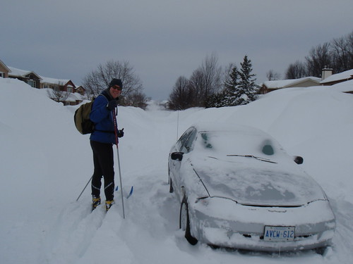 Scott skiing around abandoned car in the middle of the road.